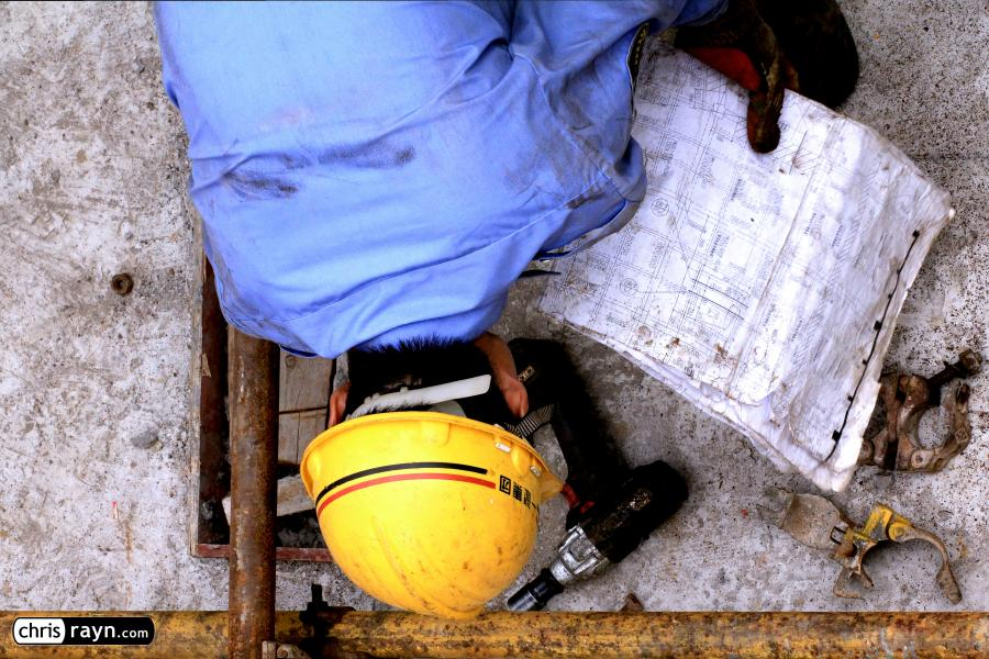 Bird's View of a Construction Worker and His Tools