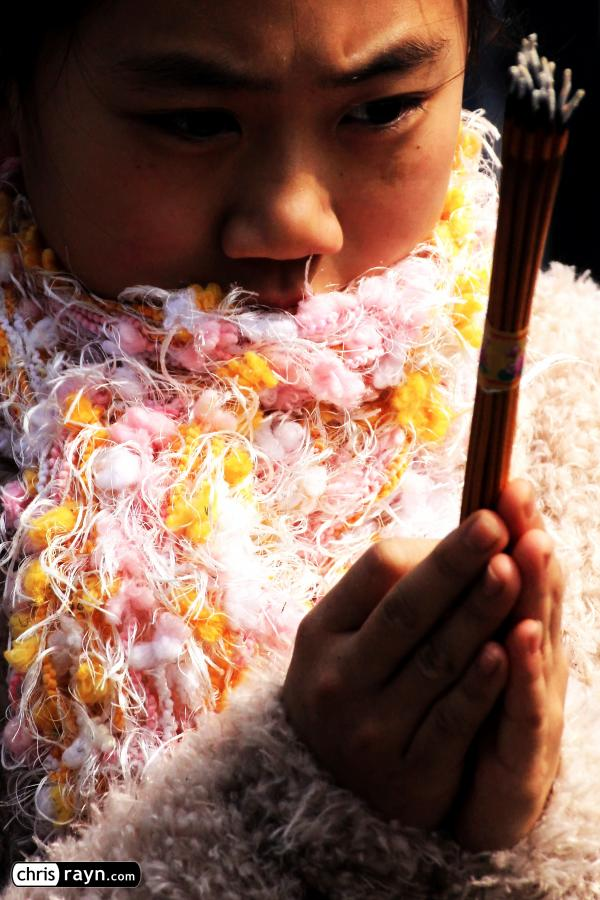 A scarf-clad Chinese girl shares her look into the future