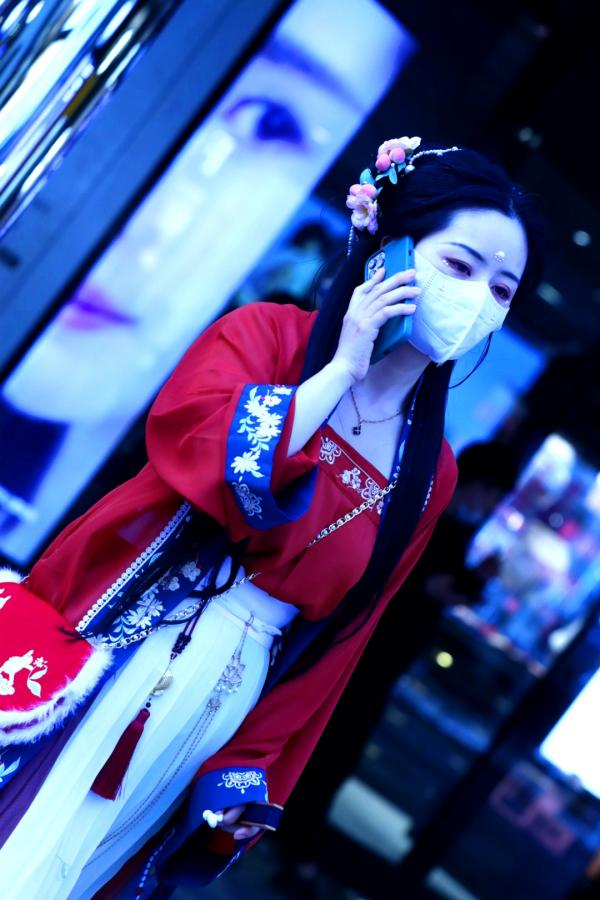 Masked Woman in Traditional Chinese Hanfu Dress in Beijing