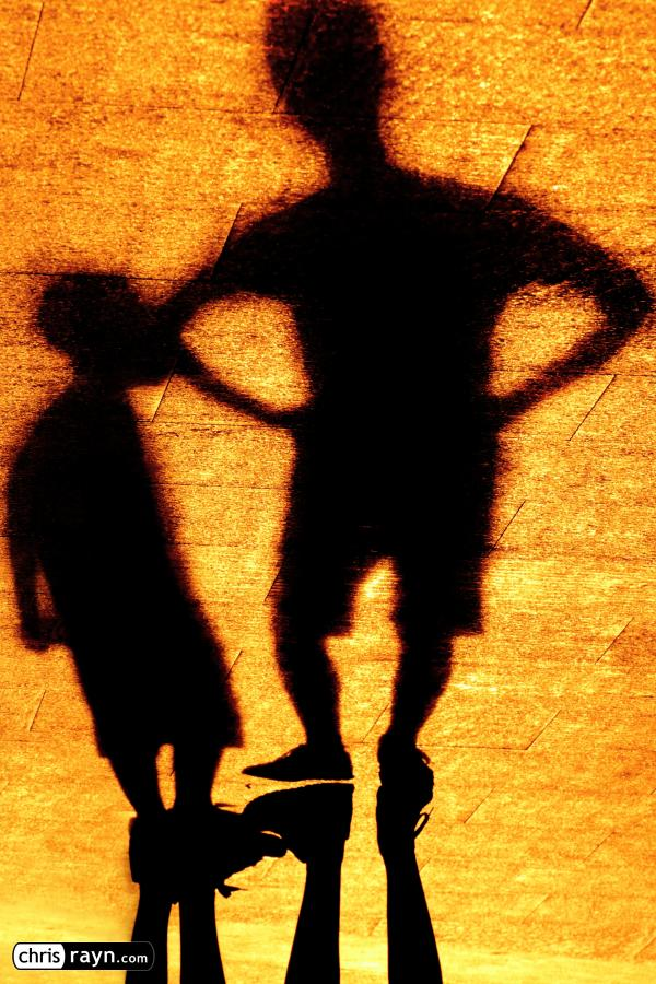 Shadows of an angry father, scolding his son