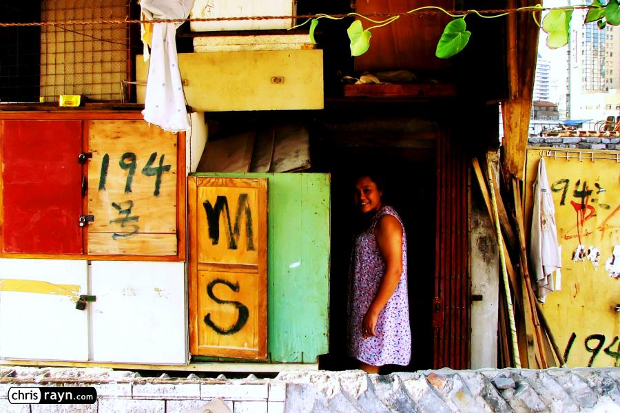 A woman in her Shanghai house marked for relocation