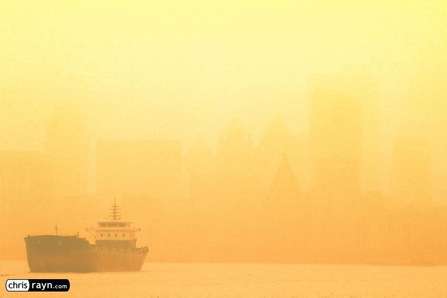 Ship On Shanghai River As Air Pollution Blankets Shore