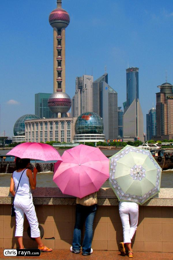 Shanghai's skyline gazed at by tourists at the Bund