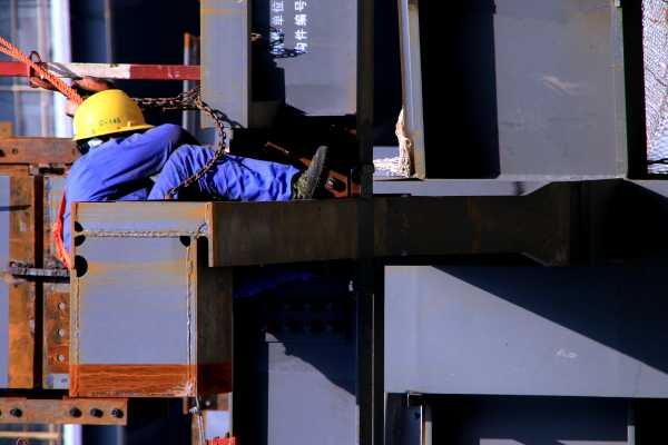 Construction Worker, Caught In Steel Beams And Iron Chains