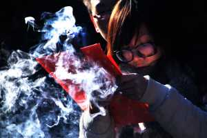 A couple sharing a moment of prayer, engulfed in incense