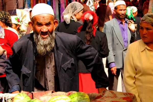 Uyghur man doing trade on Kashgar's Sunday Market