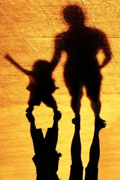 In shadows, toddler throws temper tantrum with his father