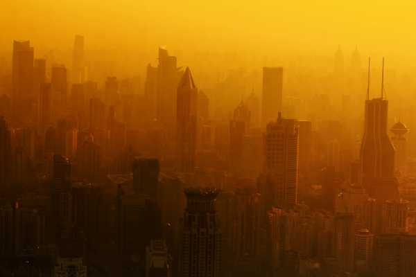 Shanghai skyscrapers fade into smog as pollution peaks