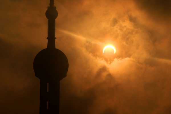 Shanghai's Oriental Pearl Tower during Solar Eclipse