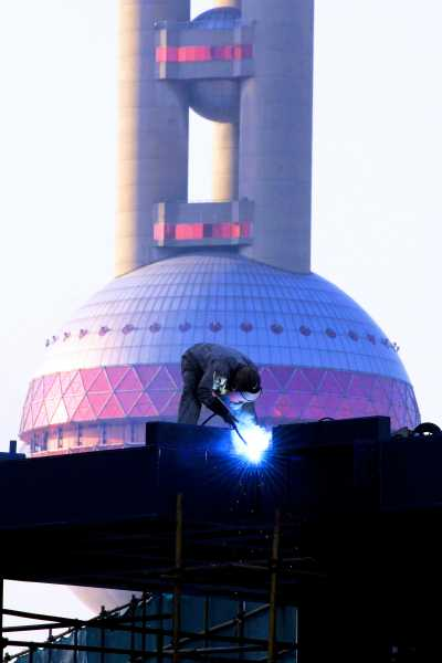 Welding in front of Oriental Pearl Tower