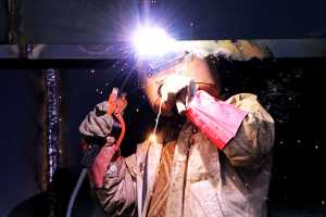 Construction worker welding a steel frame