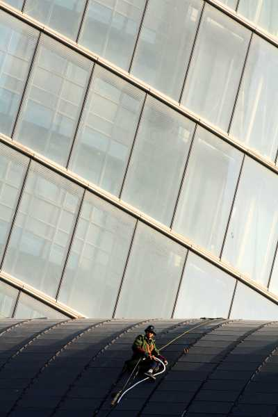 A worker stranded in front of Shanghai Tower's curtain wall
